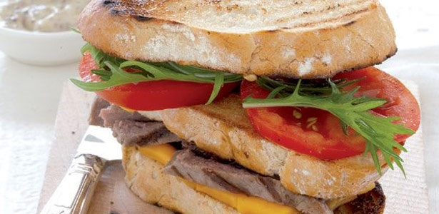 Juicy steak and cheese stacked sandwiches
